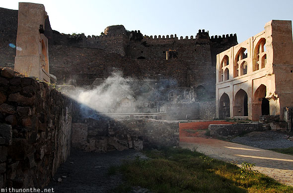 Golconda fort royal palace ruins light smoke Hyderabad