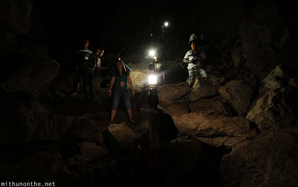 Inside sumaguing cave limestone rock guides lanterns
