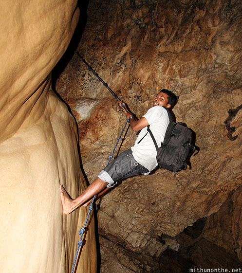 Inside sumaguing cave limestone rock Mithun climbing up