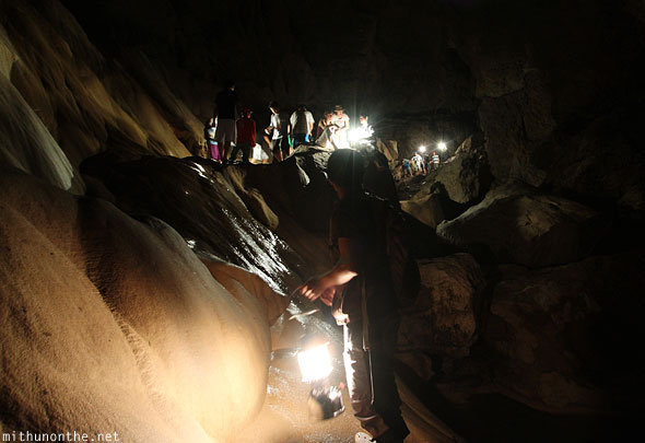 Inside sumaguing cave limestone rock people going back out