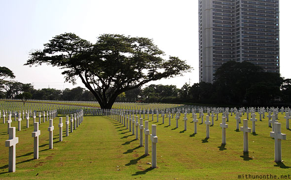 Manila American war cemetery memorial crosses shadows