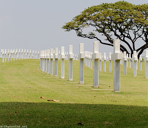 Manila American War Cemetery Memorial graves tree panorama