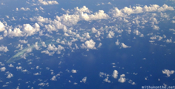 South China sea line clouds aerial view island