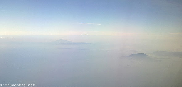 South China sea mountains above clouds aerial photograph