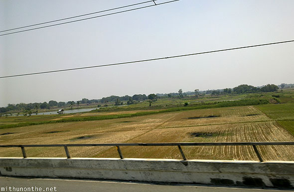 Bus journey from Dau to Manila farm countryside