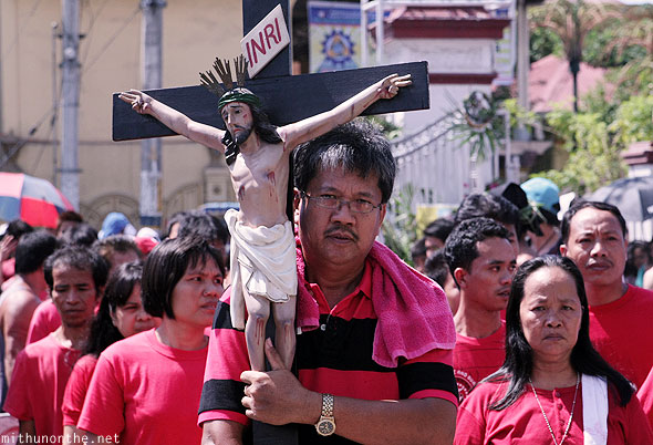 Filipinos easter procession INRI cross