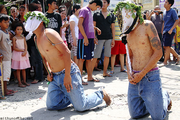 Good Friday locals kneeling Pampanga Philippines