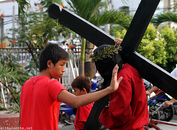 Good Friday man carrying cross San Fernando Pampanga