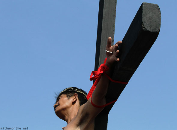 Good Friday Pampanga nailed hand on cross Philippines