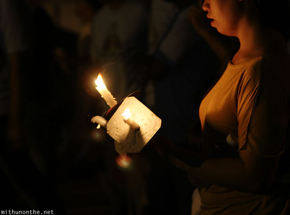 Good friday procession woman holding candle San Fernando