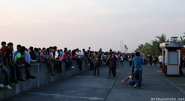 Manila Baywalk filipinos sitting sunset Philippines
