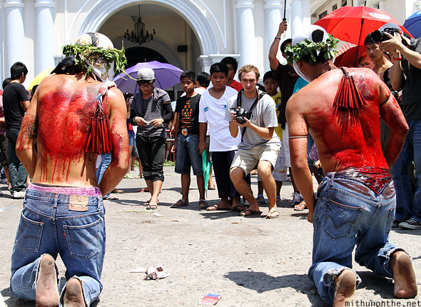 San Fernando good friday flagellation kneeling towards cross