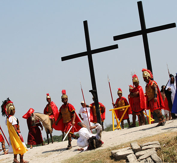 San Pedro Cutud crucifixion play Jesus rolling ground