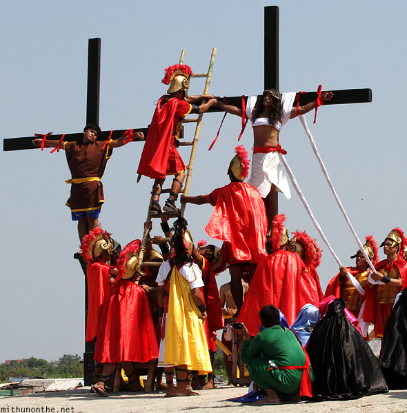 San Pedro Cutud crucifixion taking nails out of Jesus Philippines