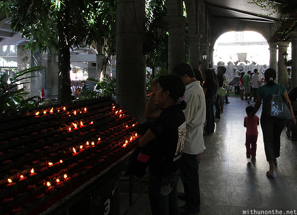 Basilica del Santo Nino church red candles praying Philippines
