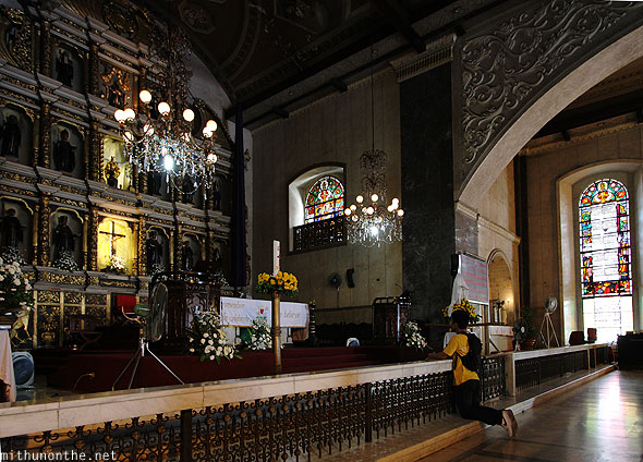 Basilica del Santo Nino man praying Philippines