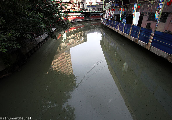 Black spots polluted river Chinatown Manila