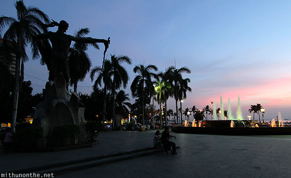 Rajah statue fountain Manila Bay Philippines sunset