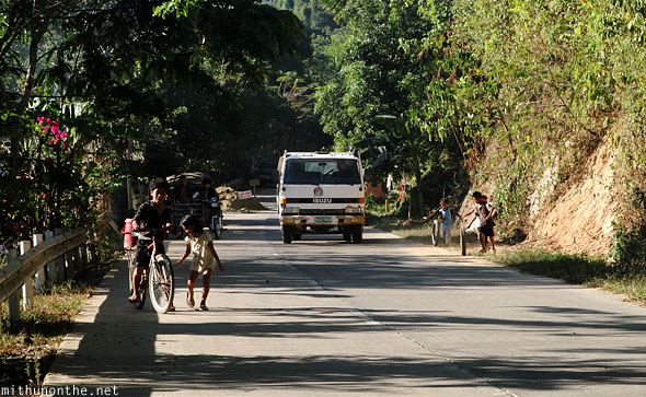 El Nido road to bus station children playing Palawan Philippines