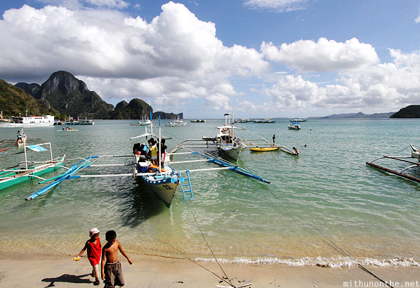 El Nido beach outrigger boats Palawan morning