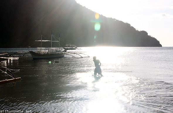Man coming out of water El Nido sunlight Palawan
