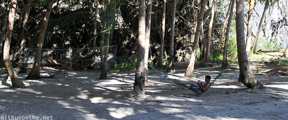 Man lying hammock 7 commandos beach El Nido Palawan