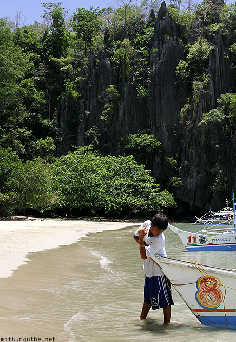 Palawan island beach boat boy Philippines