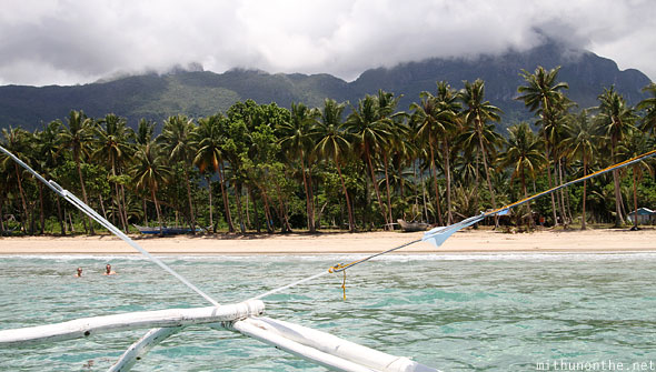Palawan island Sabang beach coconut trees Philippines