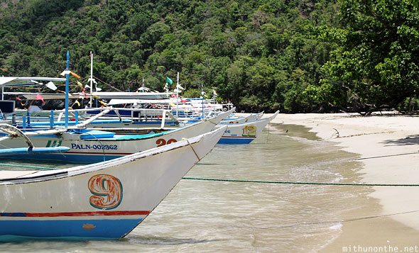 Underground river beach boats anchored Palawan Philippines