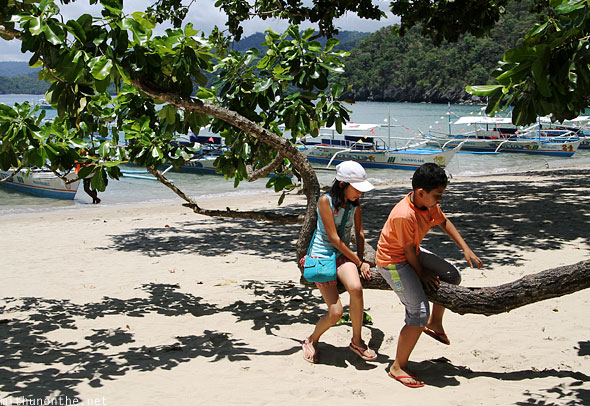 Underground river beach children playing tree Palawan