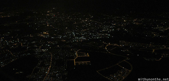 Flying over Singapore night lights