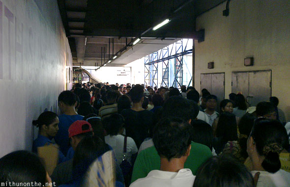 Pasay interchange LRT station evening crowds Manila