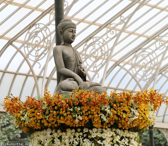 Buddha statue atop flowers Lal Bagh glasshouse Bangalore India