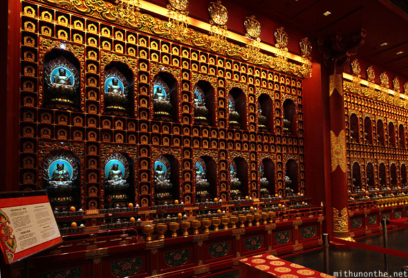 Buddha Tooth Relic temple prayer hall Buddha wall Singapore