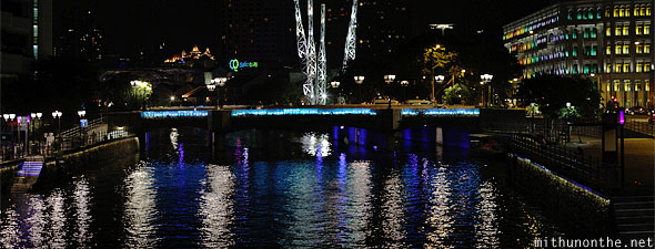 Clarke Quay at night river bridge Singapore