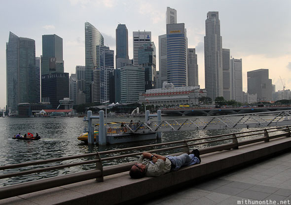 Man sleeping Marina Bay Singapore afternoon
