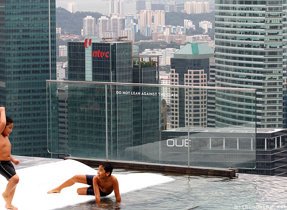 Marina Bay Sands hotel kids playing infinity pool