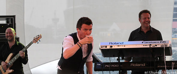 Rick Astley drinking beer Singapore concert