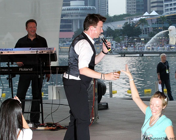 Rick Astley fan giving beer Singapore concert