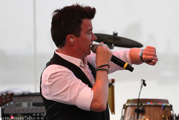 Rick Astley looking at watch Singapore GP concert