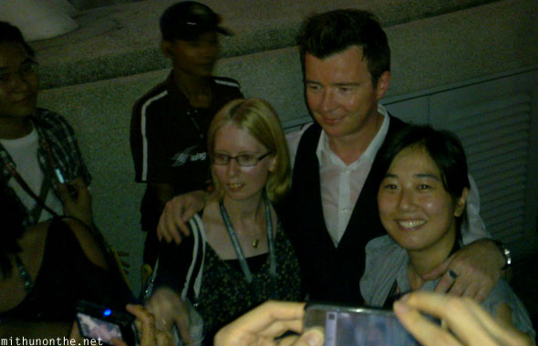 Rick Astley with fans backstage Singapore gp