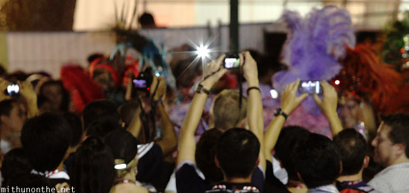 Cameras people thronging samba dancers Singapore