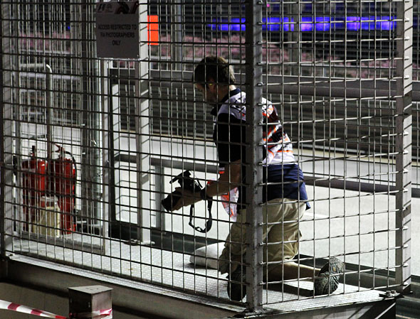 FIA photographer taking photos Singapore F1 race
