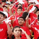 Singapore children waving flags