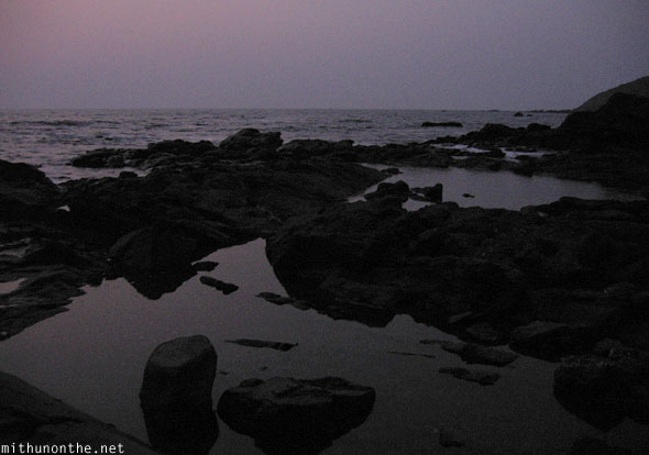 Anjuna beach rock sea Goa India
