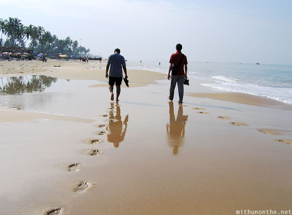Footsteps in sand Colva beach Goa India