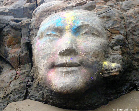Shiva stone carving face Ozran beach Goa