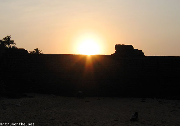 Sinquerim beach sunset Aguada Fort end Goa