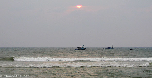 Sunset Colva beach boats Goa