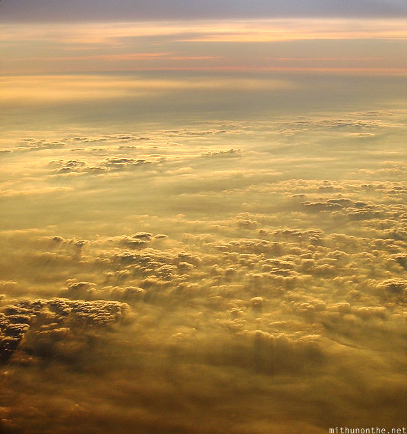 Above clouds evening sunlight India
